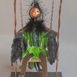 Bird girl art doll on swing