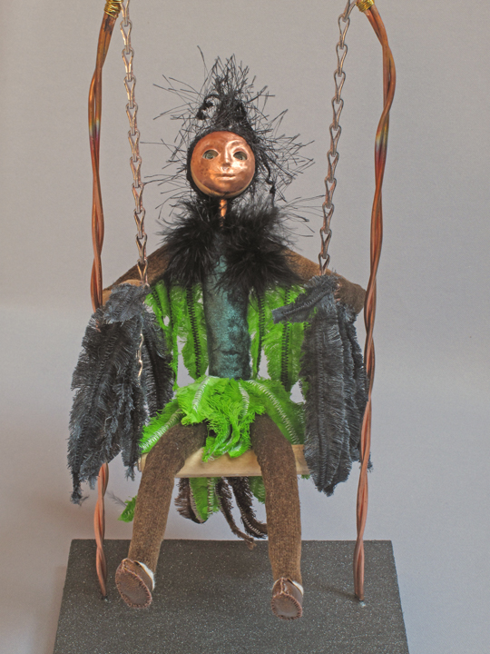 Bird girl art doll on swing