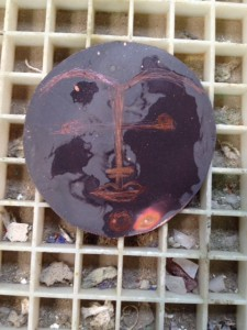 annealed copper disk with face outline