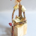 seated art doll titled Nobody's Fool