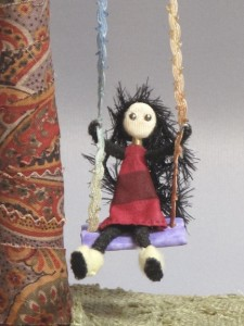 "figure from ""Folk Art on a Swing"""