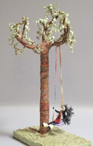 """Folk Art on a Swing"" fabric ache over wire and wood"