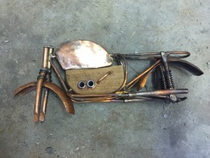 Art doll motorcycle gains gas tank and motor