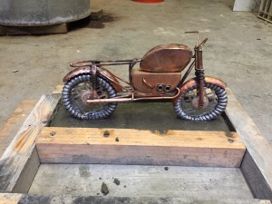 Art doll motorcycle set in concrete base