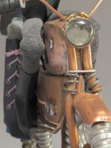 Close up of front of art doll motorcycle