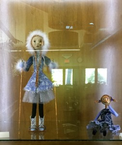 Two art dolls in Carol Woods display case