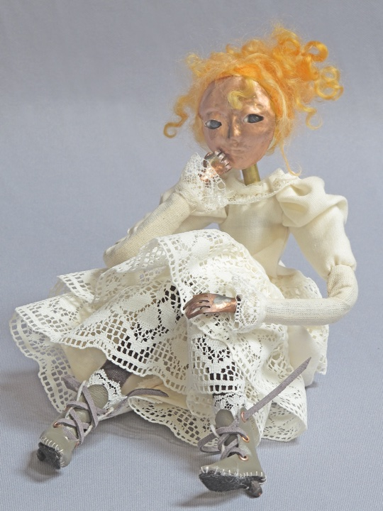 seated art doll figure sculpture titled Girl with the Curl