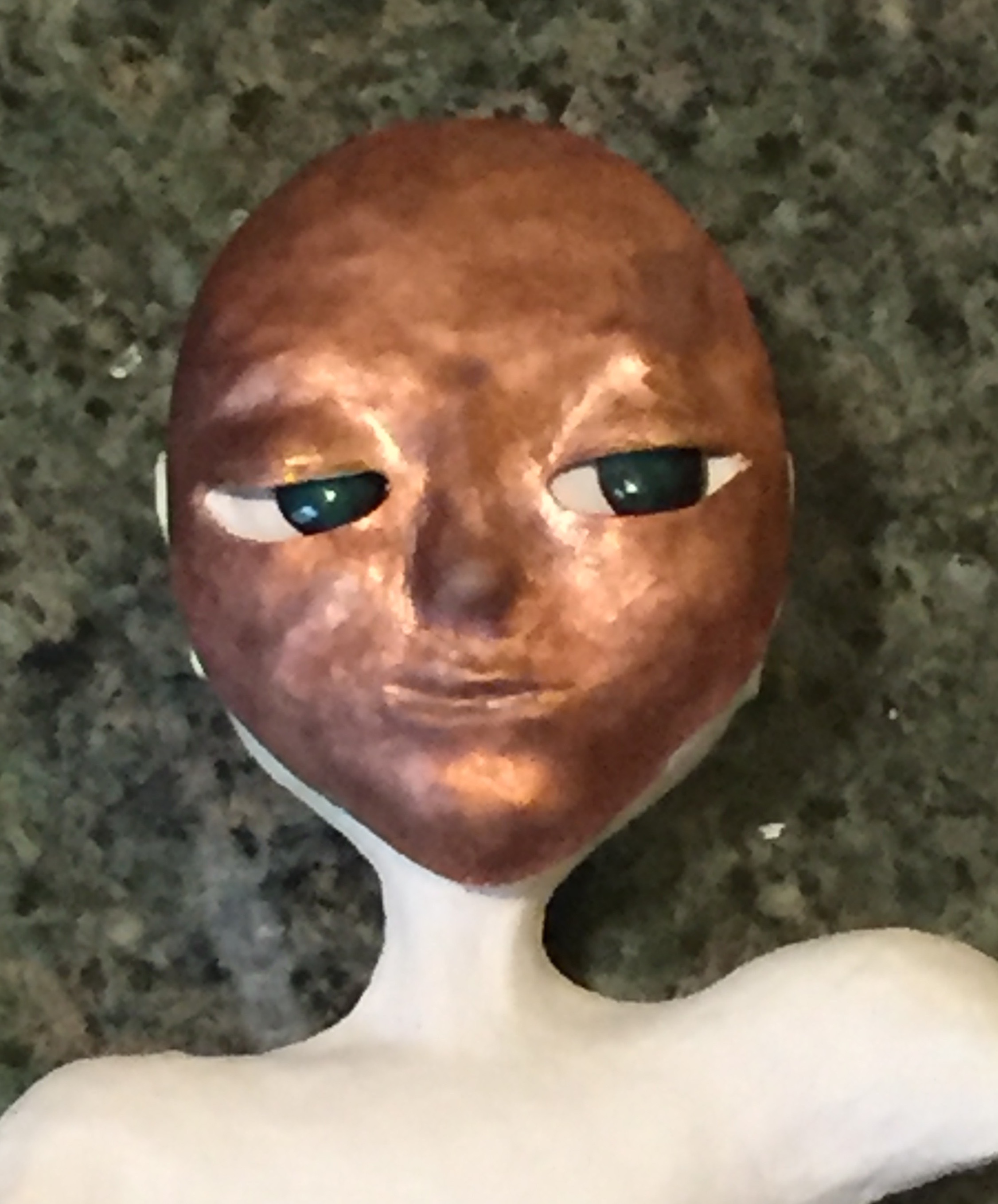 close up of art doll with face plate to guage eye placement