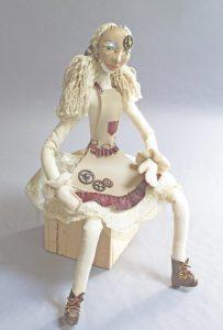 Rag-doll Retool seated art doll figure sculpture