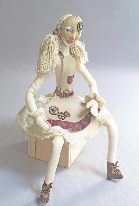 Rag-doll Retool seated art doll figure sculpture