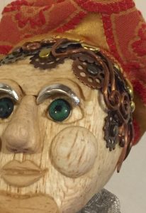 close up of facial features of Pinocchio art doll