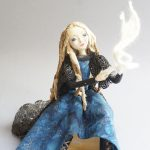 Spinning Dreams - seated magical art doll figure sculpture