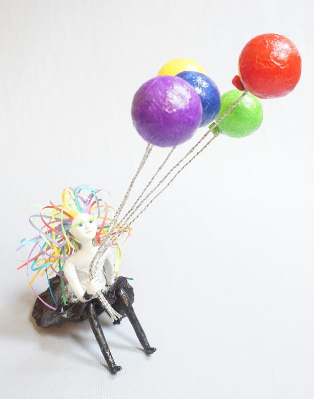 Hope- seated art doll figure sculpture with balloons