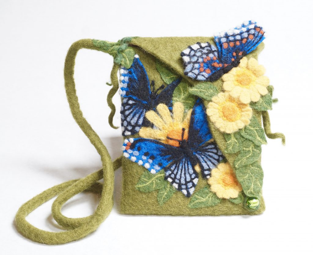 """lush"" bag with needle felted butterflies is something different"