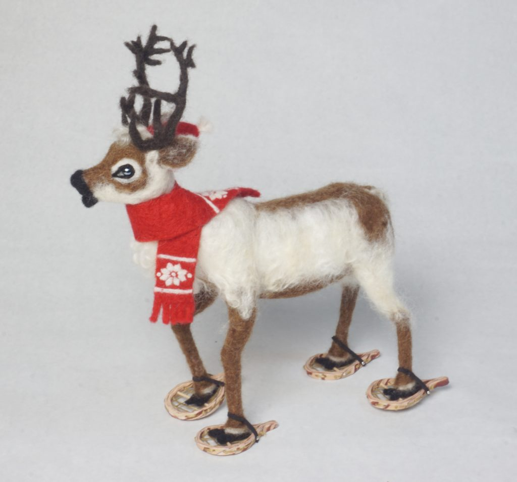 Feet on the Ground is an anthropomorphic reindeer wearing snowshoes art doll holiday sculpture