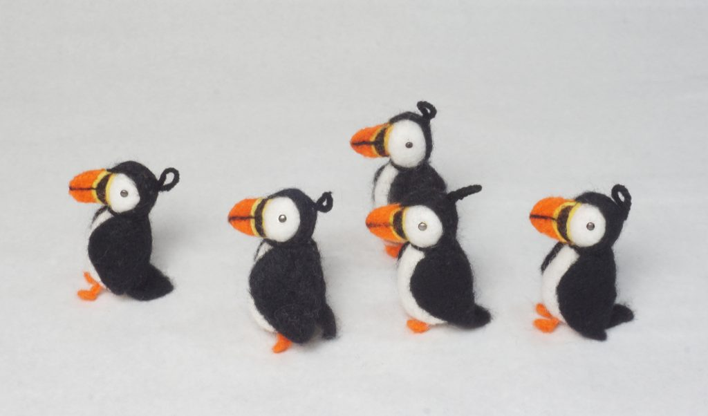 procession of needle felted puffin ornaments