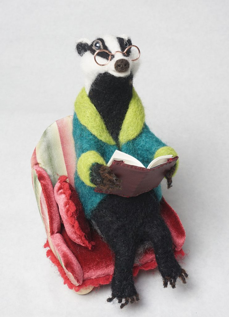 Badger Reads - anthropomorphic needle-felted badger sculpture in Edwardian arm chair with book