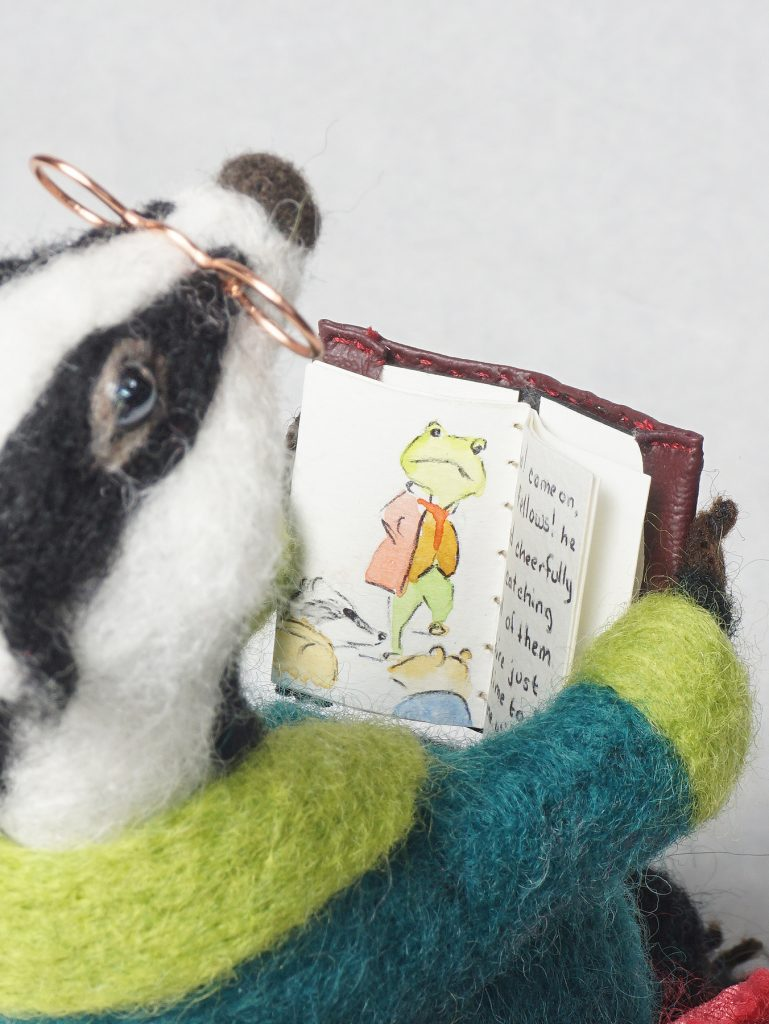close up of hand made book held by Badger Reads