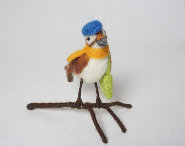 """Journey"" anthropomorphic needle felted traveling sparrow sculpture"