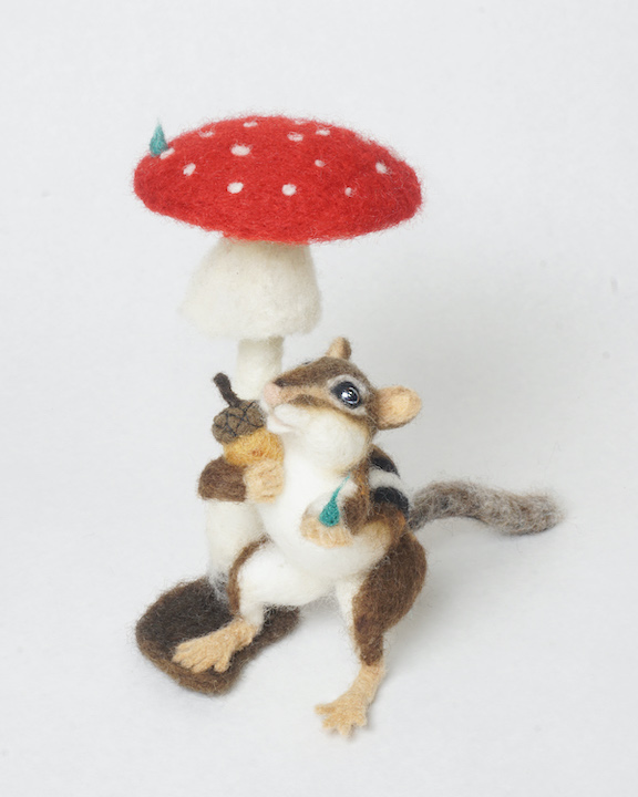 Sheltered Harvest - anthropomorphic chipmunk sheltering acorn under a toadstool.
