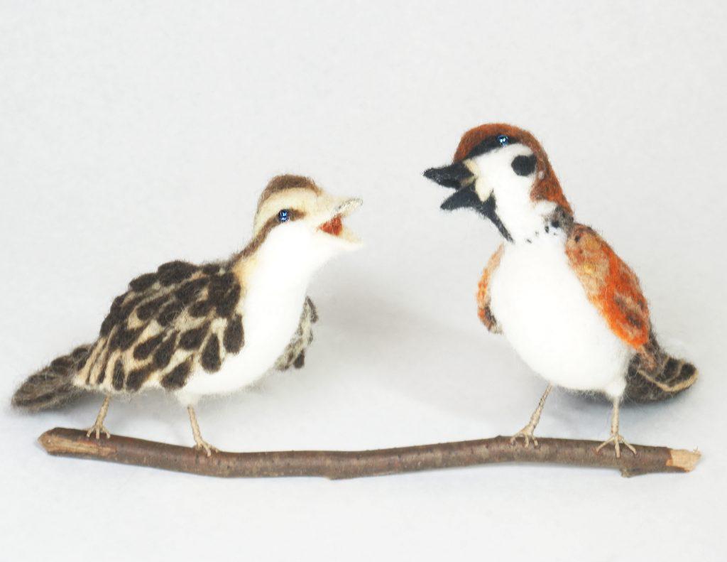 Heated Debate anthropomorphic sparrow sculpture